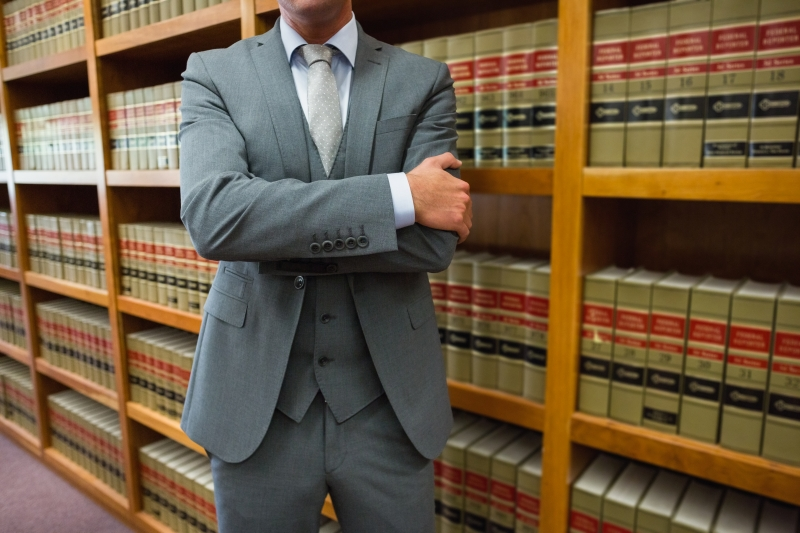 lawyer standing in front of books